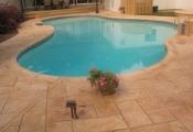 limestone-coating-concrete-pool-deck
