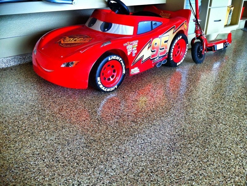 red toy car parked on an epoxy treated floor