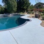 a-blue-classic-texture-pool-deck-from-afar