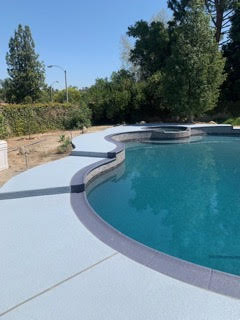side-view-of-a-blue-classic-texture-pool-deck