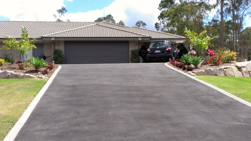 wide-grey-asphalt-driveway