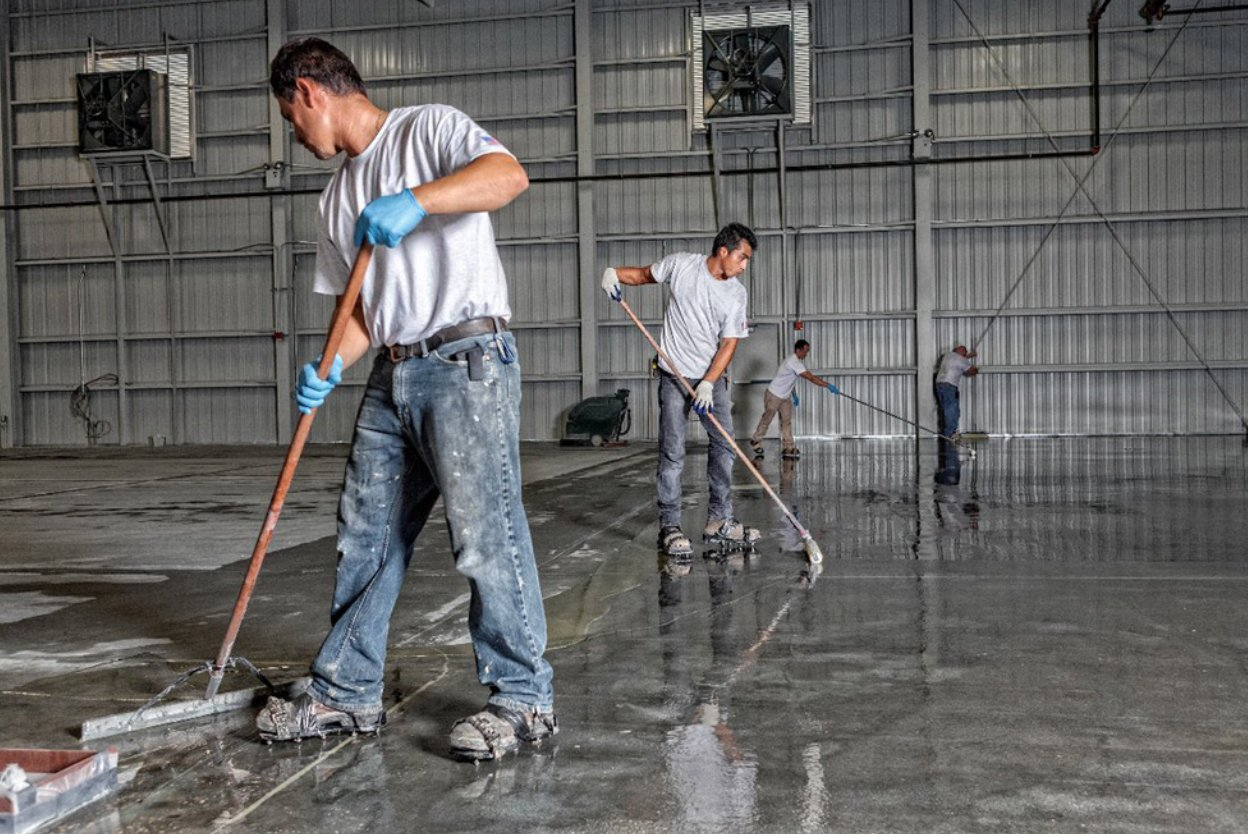 men applying epoxy on the floor