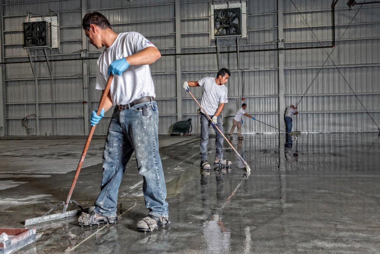 men applying epoxy on the floor