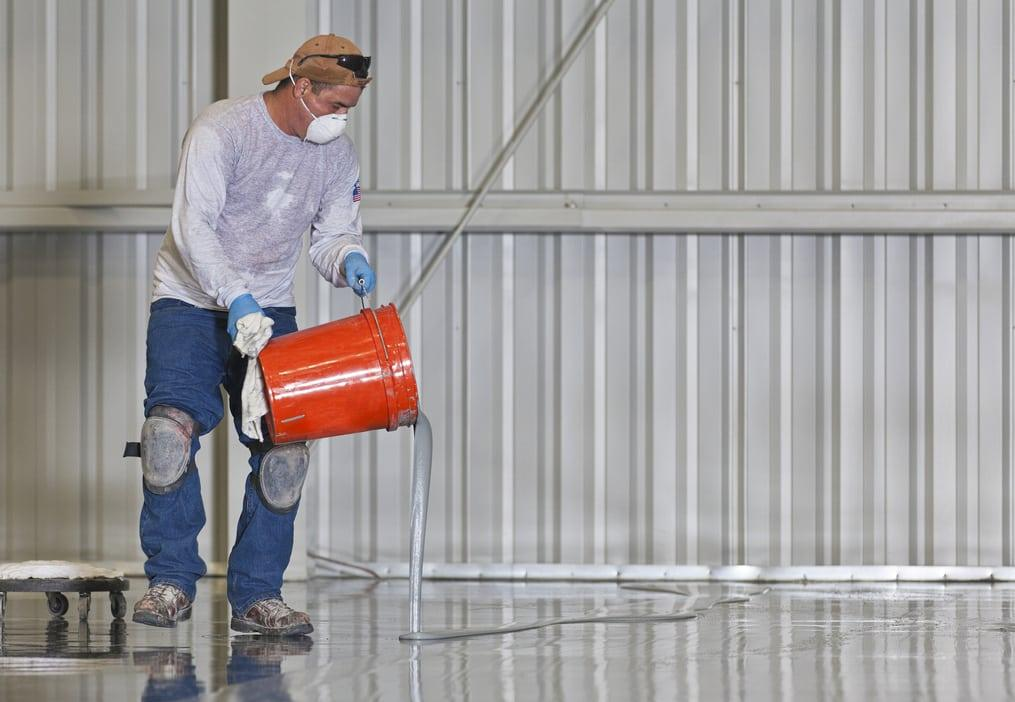 man sealing concrete