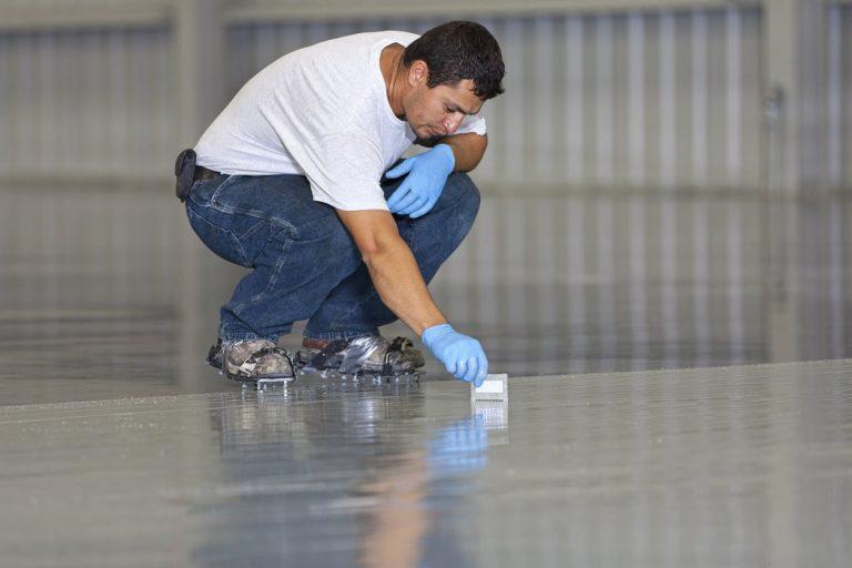 man sealing concrete floor